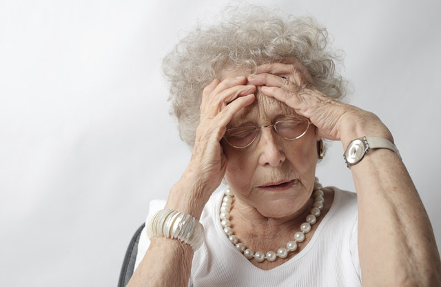 Elderly woman in pain